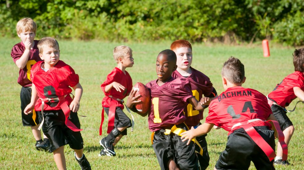 Youth playing flag football